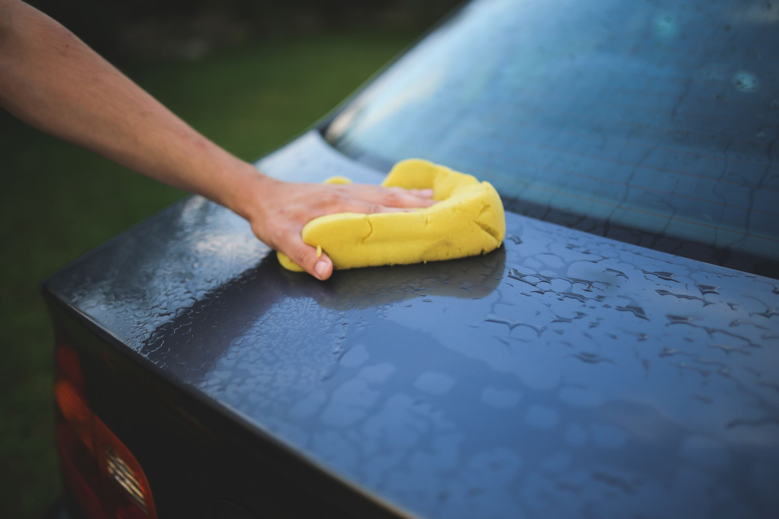 Cleaning a car with a sponge