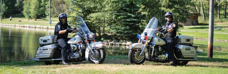 Two officers on motorcycles in a park